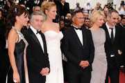 (L-R) Jury members Martina Gusman, Robert De Niro, Uma Thurman, Johnnie To,  Linn Ullmann and  Olivier Assayas attend the Opening Ceremony at the Palais des Festivals during the 64th Cannes Film Festival on May 11, 2011 in Cannes, France.