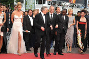 (L-R) Jury Members Martina Gusman, Uma Thurman, Robert De Niro, Olivier Assayas, Mahamat-Saleh Haroun, Jude Law, Linn Ullmann and Nansun Shi attend the Opening Ceremony at the Palais des Festivals during the 64th Cannes Film Festival on May 11, 2011 in Cannes, France.