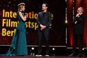 (L-R) Host Anke Engelke, Jury President Tom Tykwer and Festival director Dieter Kosslick are seen on stage at the Opening Ceremony & 'Isle of Dogs' premiere during the 68th Berlinale International Film Festival Berlin at Berlinale Palace on February 15, 2018 in Berlin, Germany.