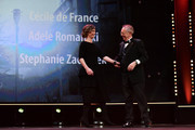 Cecile de France and Festival director Dieter Kosslick are seen on stage at the Opening Ceremony & 'Isle of Dogs' premiere during the 68th Berlinale International Film Festival Berlin at Berlinale Palace on February 15, 2018 in Berlin, Germany.