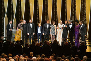 (L-R) Host of the festival Edouard Baer, Jury Members Alice Rohrwacher, Robin Campillo, Yorgos Lanthimos, Kelly Reichardt, Javier Bardem, Charlotte Gainsbourg, Jury Member Elle Fanning, wearing Chopard jewels, President of the Main competition jury Alejandro Gonzalez Inarritu, Jury Members Pawel Pawlikowski, Maimouna N'Diaye and Enki Bilal attend the Opening Ceremony during the 72nd annual Cannes Film Festival on May 14, 2019 in Cannes, France.