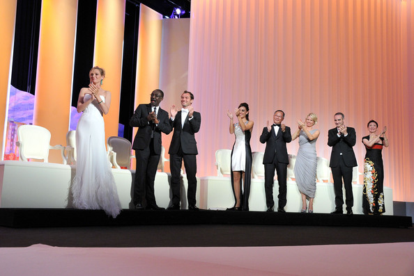 (L-R) Jury members  Uma Thurman,  Mahamat-Saleh Haroun, Jude Law, Martina Gusman, Johnnie To, Linn Ullmann, Olivier Assayas and Nansun Shi onstage at the Opening Ceremony at the Palais des Festivals during the 64th Cannes Film Festival on May 11, 2011 in Cannes, France.