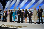 (L-R) Moderator Henri Behar, jury members Gael Garcia Bernal, Carole Bouquet, Willem Dafoe, jury president Jane Campion, Master of Ceremonies Lambert Wilson, jury members Do-yeon Jeon, Zhangke Jia, Leila Hatami and Nicolas Winding Refn attend the Opening ceremony during the 67th Annual Cannes Film Festival on May 14, 2014 in Cannes, France.