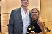 Rob Gronkowski and Ashley Bernon attend the Opening of the Salvatore Ferragamo Copley Place store on November 2, 2017 in Boston, Massachusetts.