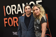 """Jason Biggs and Jenny Mollen attend the """"Orange Is The New Black"""" Final Season World Premiere at Alice Tully Hall, Lincoln Center on July 25, 2019 in New York City."""
