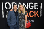 """Jason Biggs and Jenny Mollen attends the """"Orange Is The New Black"""" Final Season World Premiere at Alice Tully Hall, Lincoln Center on July 25, 2019 in New York City."""