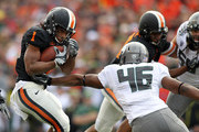 Jacquizz Rodgers #1 of the Oregon State Beavers runs the ball against Michael Clay #46 of the Oregon Ducks during the 114th Civil War on December 4, 2010 at the Reser Stadium in Corvallis, Oregon.