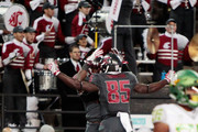 Jamal Morrow #25 of the Washington State Cougars celebrates his touchdown with teammate John Thompson #85 in the first half against the Oregon Ducks at Martin Stadium on October 1, 2016 in Pullman, Washington.