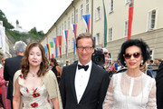 """Vicky Leandros, Thaddaeus Ropac and Bianca Jagger attend the premiere of """"Orphee aux Enfers"""" during the Salzburg Festival at Haus fuer Mozart on August 14, 2019 in Salzburg, Austria."""
