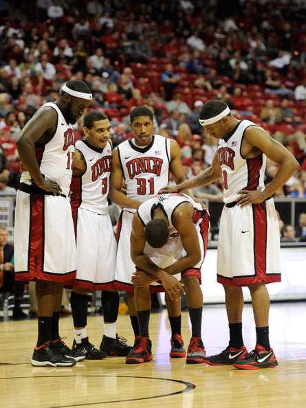 Mountain West Basketball Tournament - Quarterfinals [basketball,basketball player,ball game,basketball court,player,tournament,team sport,sport venue,sports,mike moser,teammates,anthony marshall 3,justin hawkins,play,oscar bellfield 0,l-r,unlv rebels,quarterfinals,mountain west basketball tournament]