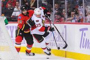 Deryk Engelland #29 of the Calgary Flames fights Chris Neil #25 of the Ottawa Senators for the puck during an NHL game at Scotiabank Saddledome on October 28, 2016 in Calgary, Alberta, Canada.