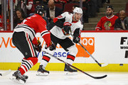 Magnus Paajarvi #56 of the Ottawa Senators passes around Connor Murphy #5 of the Chicago Blackhawks at the United Center on February 21, 2018 in Chicago, Illinois.
