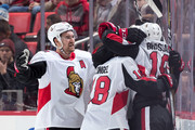 Ryan Dzingel #18 of the Ottawa Senators celebrates his third period goal with teammates Derick Brassard #19 and Mark Stone #61 during an NHL game against the Detroit Red Wings at Little Caesars Arena on January 3, 2017 in Detroit, Michigan.