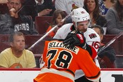 Clarke MacArthur #16 of the Ottawa Senators battles Pierre-Edouard Bellemare #78 of the Philadelphia Flyers during third period at Wells Fargo Center on April 11, 2015 in Philadelphia, Pennsylvania. The Senators defeated the Flyers 3-1 earning a spot in the playoffs.