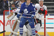 Brooks Laich #23 of the Toronto Maple Leafs waits for a shot to tip in front of Andrew Hammond #30 and Chris Neil #25 of the Ottawa Senators during an NHL game at the Air Canada Centre on March 5,2016 in Toronto, Ontario, Canada. The Senators defeated the Maple Leafs 3-2.