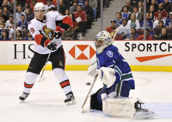 Goalie Roberto Luongo #1 of the Vancouver Canucks makes a glove save off a shot while Jason Spezza #19 of the Ottawa Senators tries to redirect the shot during the first period of NHL action on March 13, 2010 at General Motors Place in Vancouver, British Columbia, Canada. Photo by Rich Lam/Getty Images North America
