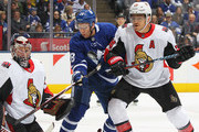 Craig Anderson #41 of the Ottawa Senators keeps an eye on a high puck while teammate Mark Borowiecki #74 checks Connor Brown #28 of the Toronto Maple Leafs during an NHL game at Scotiabank Arena on October 6, 2018 in Toronto, Ontario, Canada. The Senators defeated the Maple Leafs 5-3.
