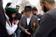 The Respect Party's George Galloway (R) speaks to a man during his election campaigning on April 24, 2015 in Bradford, England.  (Britain goes to the polls in a General Election on May 7.