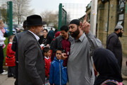 The Respect Party's George Galloway speaks to a parent outside Farnham Primary School during his election campaigning on April 24, 2015 in Bradford, England. Britain goes to the polls in a General Election on May 7.