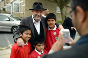 The Respect Party's George Galloway poses for a photograph outside Farnham Primary School during his election campaigning on April 24, 2015 in Bradford, England.  Britain goes to the polls in a General Election on May 7.