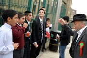 The Respect Party's George Galloway speaks to children outside Farnham Primary School during his election campaigning on April 24, 2015 in Bradford, England.  Britain goes to the polls in a General Election on May 7.