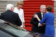 Germany's outgoing President Joachim Gauck (2ndR) and his partner Daniela Schadt (2ndL) welcome his successor Frank-Walter Steinmeier (L) and his wife Elke Buedenbender (R) ahead of the handover ceremony at the presidential Bellevue palace in Berlin on March 19, 2017.  / AFP PHOTO / Odd ANDERSEN