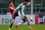 Georgi Schennikov (L) of PFC CSKA Moscow in action against Kanu of FC Terek Grozny during the Russian Premier League match between PFC CSKA Moscow and FC Terek Grozny at the Eduard Streltsov Stadium on November 10, 2013 in Moscow, Russia.