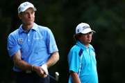Jim Furyk of the United States watches his tee shot on the third hole as Jason Dufner of the United States looks on during the final round of the 95th PGA Championship on August 11, 2013 in Rochester, New York.
