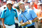 Jim Furyk of the United States watches his tee shot on the first hole as Jason Dufner of the United States looks on during the final round of the 95th PGA Championship on August 11, 2013 in Rochester, New York.
