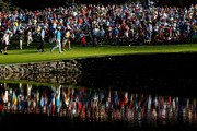 Jason Dufner and Jim Furyk of the United States walk with their caddies to the 15th green during the final round of the 95th PGA Championship on August 11, 2013 in Rochester, New York.