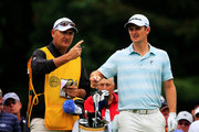 Justin Rose of England talks with caddie Mark Fulcher on the sixth tee during the second round of the 95th PGA Championship on August 9, 2013 in Rochester, New York.