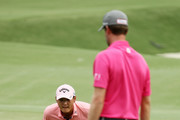 Danny Lee of New Zealand lines up a putt on the 12th green as Webb Simpson of the United States looks on during the final round of THE PLAYERS Championship on the Stadium Course at TPC Sawgrass on May 13, 2018 in Ponte Vedra Beach, Florida.