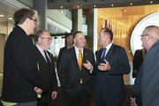 """New Zealand Prime Minister John Key and Australian Prime Minister Tony Abbott talk during a tour of """"Gallipoli: The scale of our war"""" exhibition at Te Papa Museum on April 20, 2015 in Wellington, New Zealand. Australian Prime Minister Tony Abbott is in Wellington today as part of commemorations ahead of the 100th anniversary of the ANZAC landings at Gallipoli."""