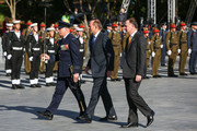 New Zealand Prime Minister John Key (R) and Australian Prime Minister Tony Abbott depart the opening of the Australian Memorial at Pukeahu National War Memorial Park on April 20, 2015 in Wellington, New Zealand. Australian Prime Minister Tony Abbott is in Wellington today as part of commemorations ahead of the 100th anniversary of the ANZAC landings at Gallipoli.