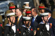New Zealand Prime Minister John Key (L) and Australian Prime Minister Tony Abbott inspect the guard during the opening of the Australian Memorial at Pukeahu National War Memorial Park on April 20, 2015 in Wellington, New Zealand. Australian Prime Minister Tony Abbott is in Wellington today as part of commemorations ahead of the 100th anniversary of the ANZAC landings at Gallipoli.