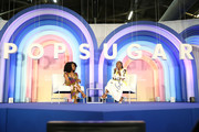 """Amy Aniobi and Issa Rae speak during """"Be Your Own Powerhouse"""" conversation during POPSUGAR Play/Ground at Pier 94 on June 23, 2019 in New York City."""