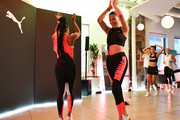 PUMA Global Ambassador Adriana Lima (R) and Deja Riley lead a high-intensity workout class as PUMA And Refinery29 Host The Launch Of The New PUMA LQD CELL Shatter Shoe at Refinery29 on July 11, 2019 in New York City.