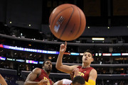Derrick Williams #23 of the Arizona Wildcats battles for a loose ball in front of Alex Stepheson #1 and Nikola Vucevic #5 of the USC Trojans in the second half in the semifinals of the 2011 Pacific Life Pac-10 Men's Basketball Tournament at Staples Center on March 11, 2011 in Los Angeles, California.