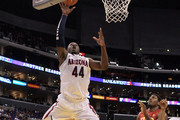 Solomon Hill #44 of the Arizona Wildcats attempts a lay up in the first half against Alex Stepheson #1 of the USC Trojans in the semifinals of the 2011 Pacific Life Pac-10 Men's Basketball Tournament at Staples Center on March 11, 2011 in Los Angeles, California.