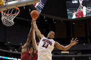 Derrick Williams #23 of the Arizona Wildcats goes up for a rebound in front of Alex Stepheson #1 of the USC Trojans in the second half in the semifinals of the 2011 Pacific Life Pac-10 Men's Basketball Tournament at Staples Center on March 11, 2011 in Los Angeles, California.