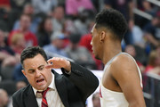 Head coach Sean Miller of the Arizona Wildcats congratulates Allonzo Trier #35 during a timeout in the championship game of the Pac-12 basketball tournament against the USC Trojans at T-Mobile Arena on March 10, 2018 in Las Vegas, Nevada. The Wildcats won 75-61.