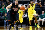 Mike Moser #0 of the Oregon Ducks battles for the ball against Tim Thomas #42 of the Pacific Tigers on November 29, 2013 at Matthew Knight Arena in Eugene, Oregon.