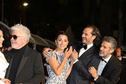 "(L-R) Director Pedro Almodovar, Penelope Cruz, wearing Atelier Swarovski Fine Jewelry, Asier Etxeandia and Leonardo Sbaraglia depart the screening of ""Pain And Glory (Dolor Y Gloria/Douleur Et Gloire)"" during the 72nd annual Cannes Film Festival on May 17, 2019 in Cannes, France."