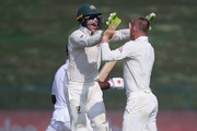 Marnus Labuschagne and Tim Paine of Australia celebrates after dismissing Fakhar Zaman of Pakistan  during day one of the Second Test match between Australia and Pakistan at Sheikh Zayed stadium on October 16, 2018 in Abu Dhabi, United Arab Emirates.