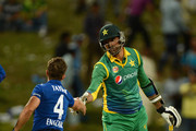 Mohammad Irfan of Pakistan shakes hands with James Taylor of England after the 2nd One Day International between Pakistan and England at Zayed Cricket Stadium on November 13, 2015 in Abu Dhabi, United Arab Emirates.