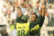 Shoaib Malik and Shoaib Akhtar of Pakistan celebrate the wicket of Mark Boucher during the Fifth One Day International match between Pakistan and South Africa at Gaddafi Stadium on 29 October, 2007 in Lahore, Pakistan.