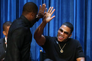 Actor/co creator/executive producer Kevin Hart (L) and actor Nelly speak during The Paley Center for Media Presents 'An Evening with Real Husbands of Hollywood' at The Paley Center for Media on October 14, 2014 in Beverly Hills, California.