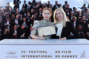 """Emily Beecham, winner of the Best Actress award for her role in """"Little Joe"""" and Director Jessica Hausner attend thephotocall for Palme D'Or Winner during the 72nd annual Cannes Film Festival on May 25, 2019 in Cannes, France."""