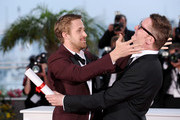 Actor Ryan Gosling (L) and 2011 Best Director Nicolas Winding Refn of the film 'Drive' pose at the Palme d'Or Winners Photocall at the Palais des Festivals during the 64th Cannes Film Festival on May 22, 2011 in Cannes, France.