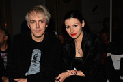 Nick Rhodes and Nefer Suvio attend the Pam Hogg show at the Fashion Scout Venue during London Fashion Week SS14 at Freemasons Hall on September 16, 2013 in London, England.